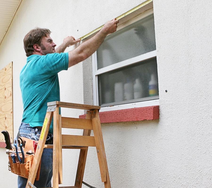 bigstock-A-man-measuring-windows-for-hu-11978195.jpg