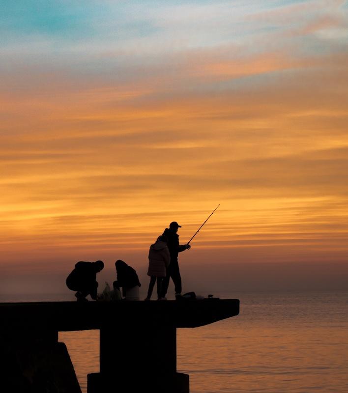 night fishing on a dock