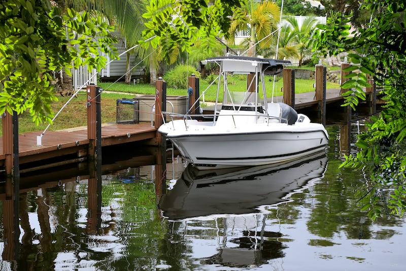 bigstock-Close-up-parked-boat-at-dock-o-271420060