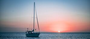 sailboat on the water during sunset