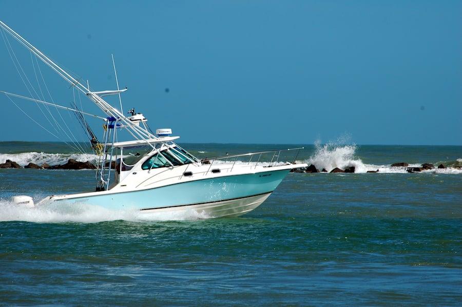 sport fishing convertable boat in blue waters ocean