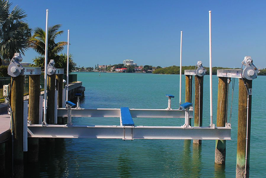 boat lift on blue water in florida